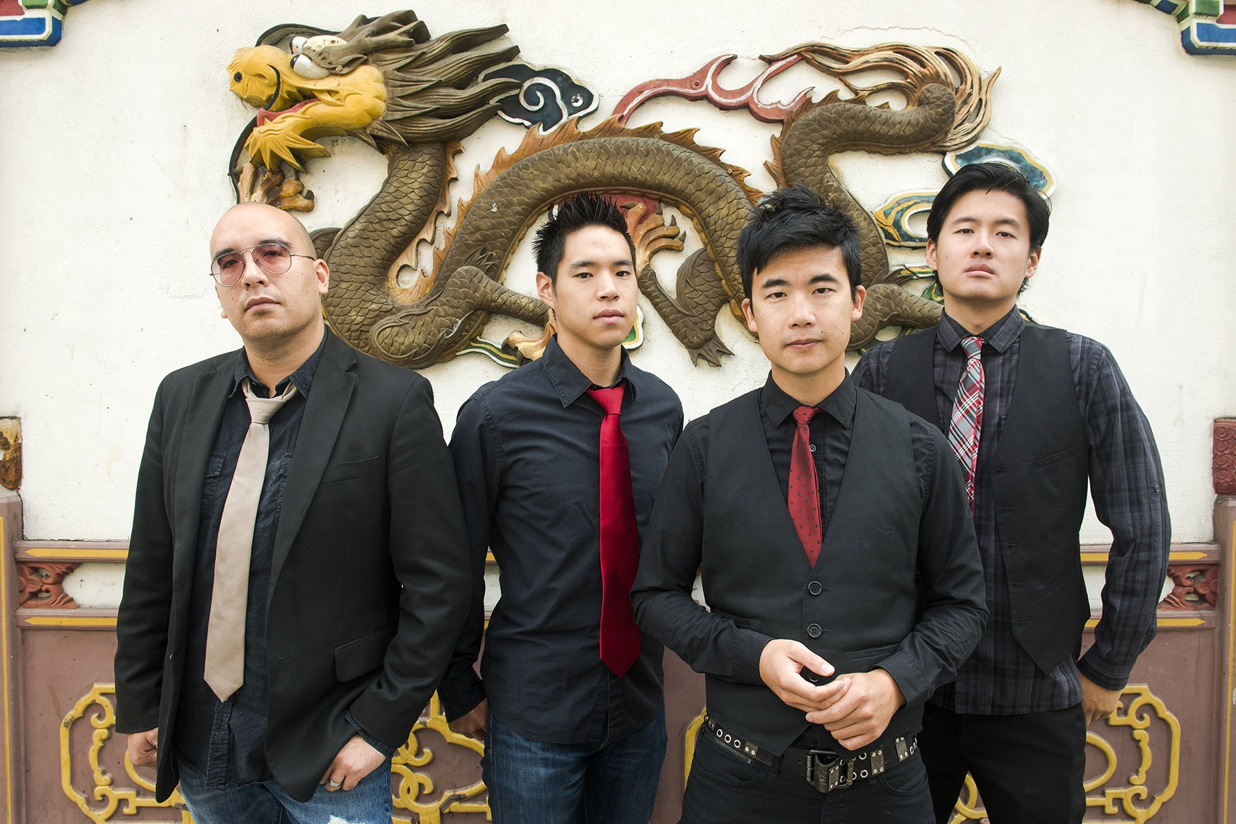 "Portrait of Asian-American band The Slants (L-R: Joe X Jiang, Ken Shima, Tyler Chen, Simon ""Young"" Tam, Joe X Jiang) in Old Town Chinatown, Portland, Oregon, USA on 21st August 2015. (Photo by: Anthony Pidgeon/Redferns)"